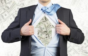 Businessman is tearing the shirt on the chest. Dollar notes under the shirt. The concept of the business soul. Dollar notes background.