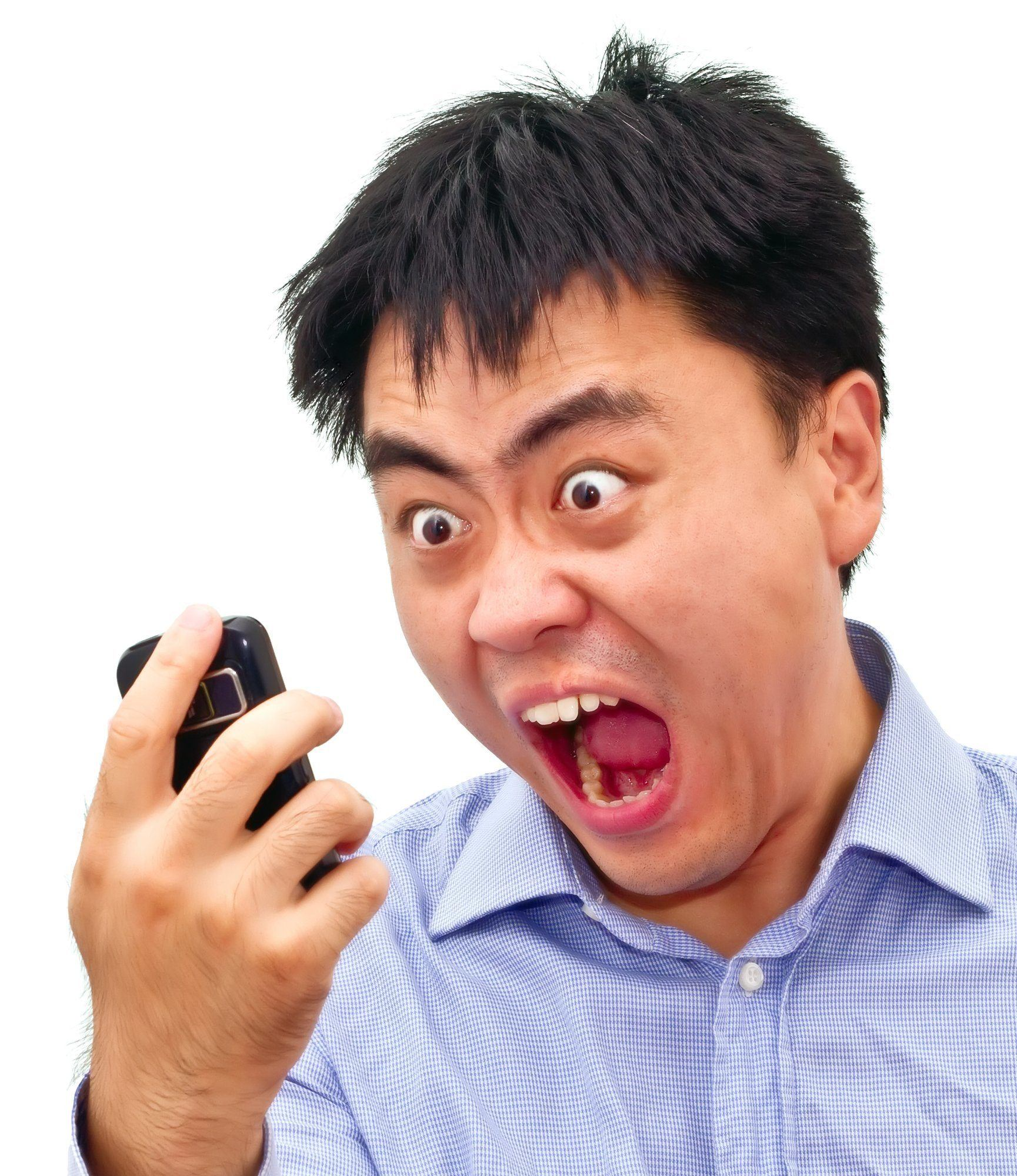 Crazy angry aian man yelling at phone